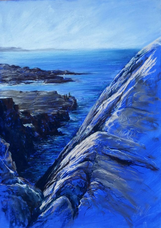 An original pastel of the coastal view from cliffs in North West Scotland, looking over the edge to the rocks and sea below. Low sunlight glints on the sea, and small figures are fishing below. The greys, deep blue and purple pastel marks are applied onto an ultramarine primed surface.