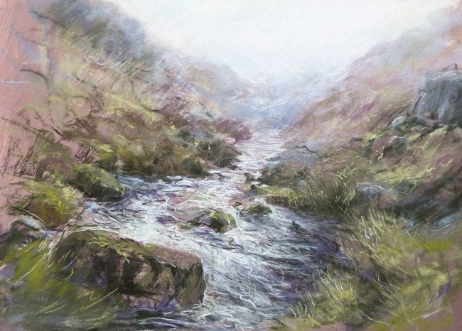 A pastel painting of a moorland stream, capturing fast water rippling between rocks and grassy banks. Vigorous pastel mark making describes the windswept grasses, the twisting water and the soft mist on the distant hills.